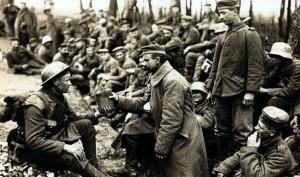 a British soldier offers a German prisoner a drink